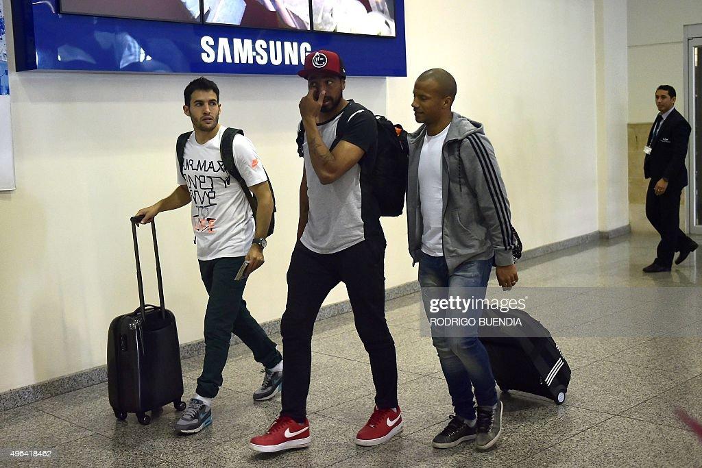 Uruguay's players Camilo Mayada (L), Alvaro Perira (C) and Carlos Sanchez arrive at the airport in Guayaquil, Ecuador on November 9, 2015. Uruguay will face Ecuador on November 12 in a FIFA World Cup Russia 2018 qualifier.