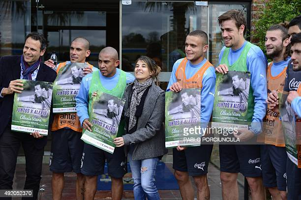 Uruguay's players pose with friends of Uruguayan goalkeeper Alexis Viera who recovers from gunshot wounds received in Colombia to promote a charity...