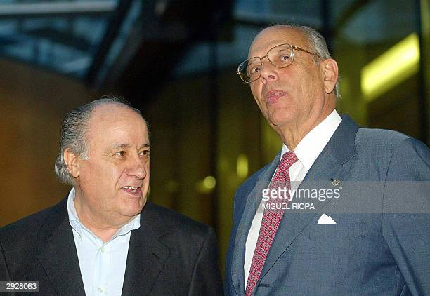 Uruguay's President Jorge Battle chats with the manager of the company Zara Amancio Ortega in Arteixo near Coruna northwestern Spain 04 February 2004...