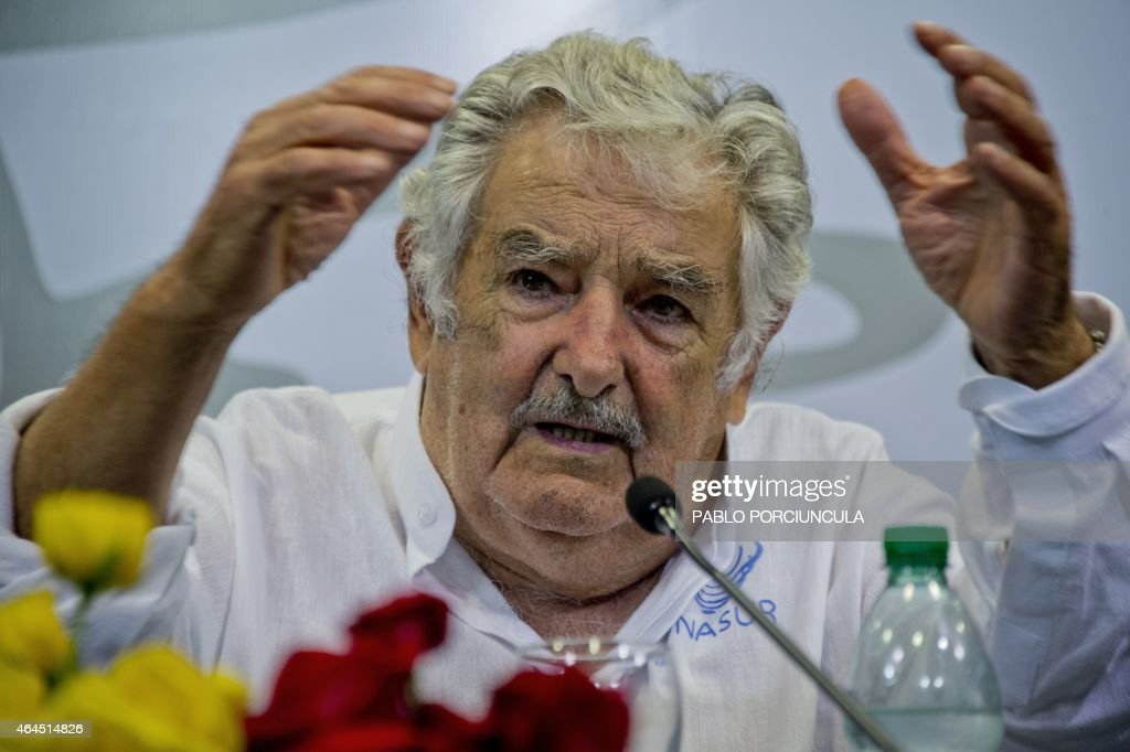 Uruguay's President <a gi-track='captionPersonalityLinkClicked' href=/galleries/search?phrase=Jose+Mujica&family=editorial&specificpeople=637688 ng-click='$event.stopPropagation()'>Jose Mujica</a> speaks with journalists after signing agreements with his Bolivian counterpart Evo Morales (out of frame) in Montevideo on February 26, 2015, two days before newly elected leftist president Tabare Vazquez assumes office, succeeding Mujica. AFP PHOTO / Pablo PORCIUNCULA