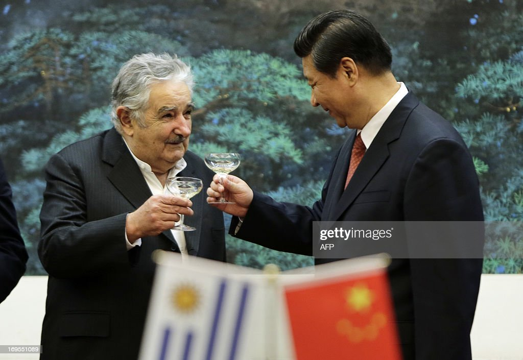 Uruguay's President Jose Mujica (L) toasts with China's President Xi Jinping during a signing ceremony at the Great Hall of the People in Beijing on May 27, 2013.