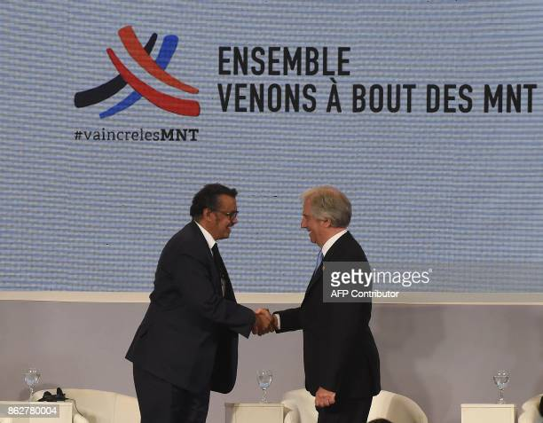 Uruguay's President Tabare Vazquez and Tedros Adhanom Ghebreyesus WHO DirectorGeneral shake hands before the opening of the Global Conference on...