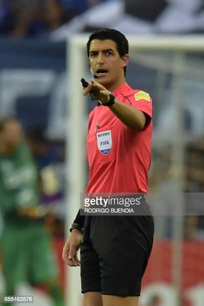Uruguay's referee Leodan Gonzalez gestures during the 2017 Copa Libertadores football match between Ecuador's Emelec and Peru's Melgar at George...