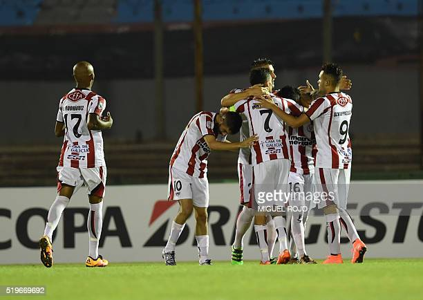 Uruguay's River Plate footballers celebrate the goal against Uruguay's Nacional during their Libertadores Cup football match at the Centenario...