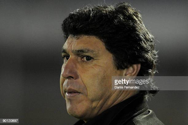 Uruguay's River Plate head coach Juan Ramon Carrasco watches his players during their match against Bolivia's Blooming as part of the Copa Nissan...