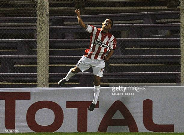 Uruguay's River Plate player Cristian Techera celebrates after scoring the team's fouth goal against Bolivia's Blooming Jorge Ortiz during their...