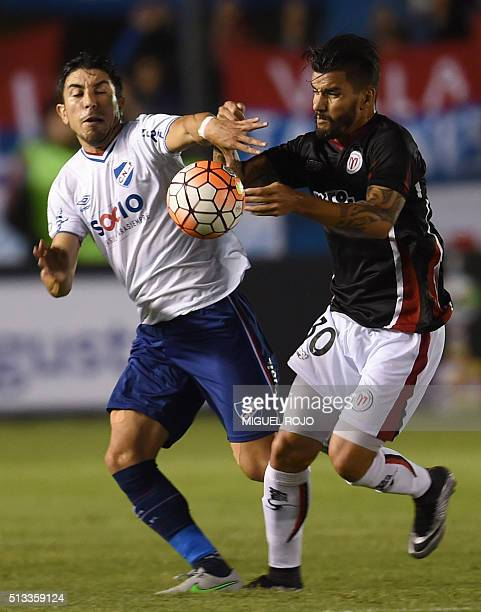 Uruguay's River Plate player Matias Jines vies for the ball with Uruguay's Nacional player Jorge Fucile during their Libertadores Cup football match...