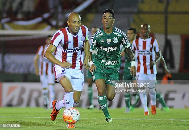 Uruguay's River Plate Ronaldo Conceicao vies for the ball witht Brazil's Palmeiras player Lucas Barrios during their Copa Libertadores football match...