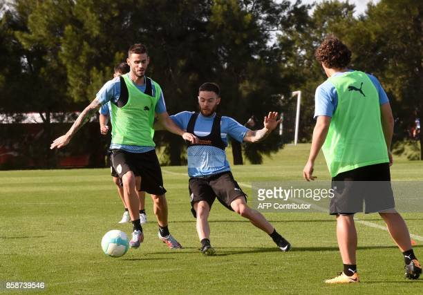 Uruguay's Rodrigo Bentancur and Nahitan Nandes take part in a training session on October 7 at the Complejo Celeste training center in Barros Blancos...
