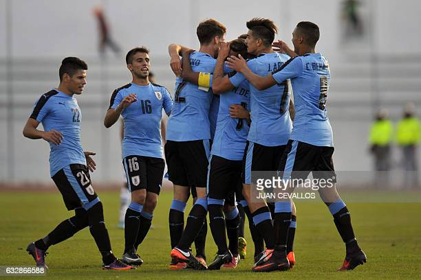 Uruguay's Rodrigo Bentancur celebrates with teammates a goal against Bolivia during a South American Championship U20 football match at the Olimpico...