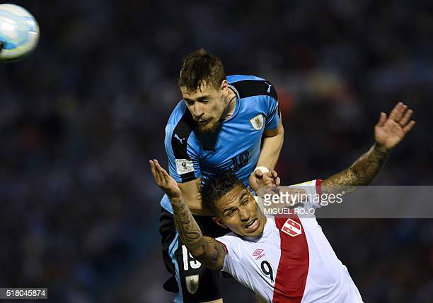 Uruguay's Sebastian Coates and Peru's Paolo Guerrero vie for the ball during their Russia 2018 FIFA World Cup South American Qualifiers' football...
