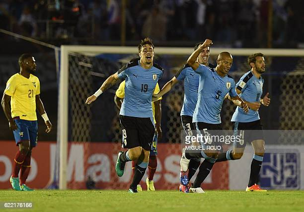 Uruguay's Sebastian Coates celebrates with teammates after scoring against Ecuador during their 2018 FIFA World Cup qualifier football match in...