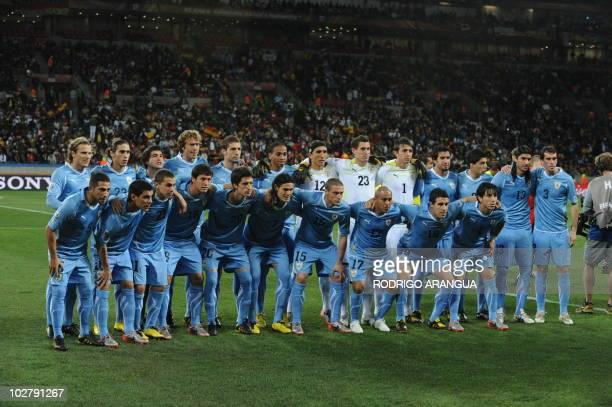 Uruguay's striker Diego Forlan defender Martin Caceres midfielder Nicolas Lodeiro defender Diego Lugano midfielders Sebastian Eguren and Alvaro...