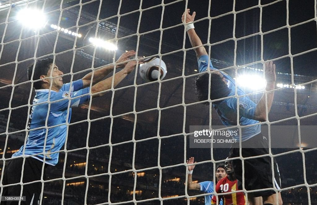 Uruguay's striker Luis Suarez stops the ball with the hand leading to a red card and a penalty for Ghana during the extratime of 2010 World Cup...
