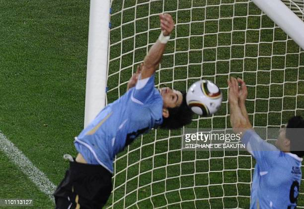 Uruguay's striker Luis Suarez stops the ball with the hands leading to a red card and a penalty for Ghana during the extratime of 2010 World Cup...