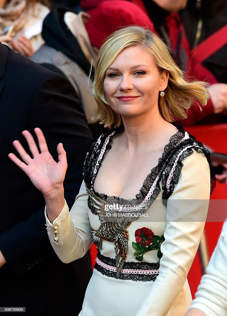 Us actress Kirsten Dunst arrives for a photo call for the film ' Midnight Special by Jeff Nichols' screened in competition of the 66th Berlinale Film Festival in Berlin on February 12, 2016. / AFP / John MACDOUGALL