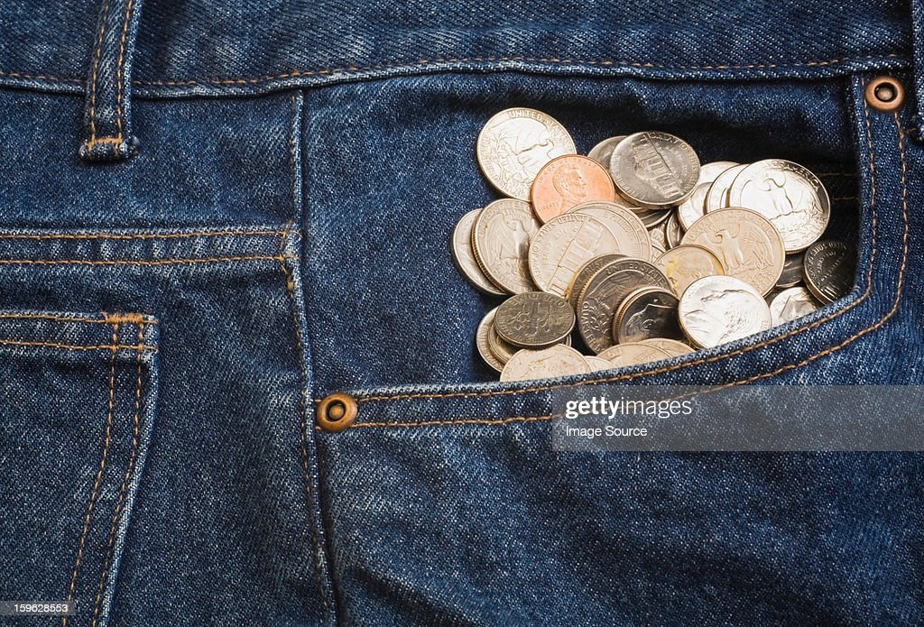 Us coins in jeans pocket : Stock Photo