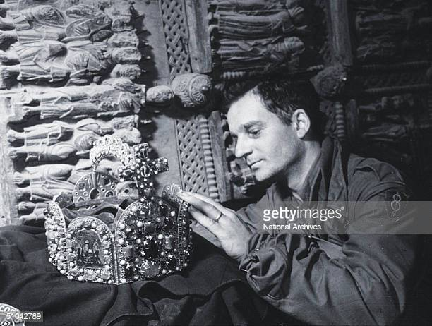 A Us Soldier Inspects A Priceless Treasure Taken From Jews By The Nazi's And Stashed In The Heilbron Salt Mines May 3 1945 In Germany