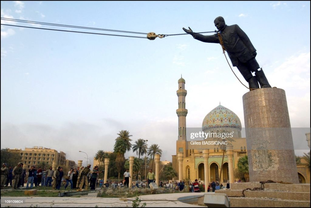 Us Troops Enter Central Baghdad And Topple Statue Of <a gi-track='captionPersonalityLinkClicked' href=/galleries/search?phrase=Saddam+Hussein&family=editorial&specificpeople=121553 ng-click='$event.stopPropagation()'>Saddam Hussein</a> On April 9, 2003 In Baghdad, Iraq. Liberated By U.S. Led Troops, Thousands Of Jubilant Iraqis Celebrated The Collapse Of <a gi-track='captionPersonalityLinkClicked' href=/galleries/search?phrase=Saddam+Hussein&family=editorial&specificpeople=121553 ng-click='$event.stopPropagation()'>Saddam Hussein</a> Murderous Regime, Beheading A Toppled Statue Of Their Longtime Ruler In The Center Of Baghdad And Looting Government Sites.