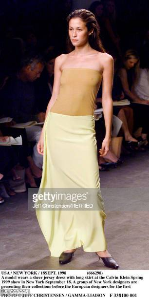 Usa / New York / 18Sept 1998 A Model Wears A Sheer Jersey Dress With Long Skirt At The Calvin Klein Spring 1999 Show In New York September 18 A Group...