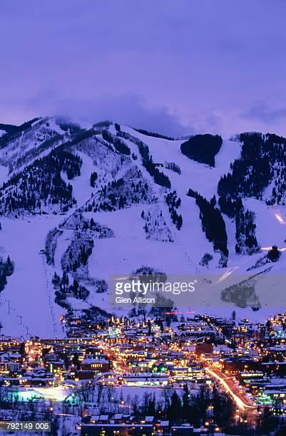USA,Colorado,Aspen city illuminated at twilight,mountains in backgroun