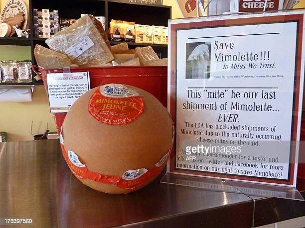Francecheesefoodhealthdistribution A sign reads 'Save Mimolette' at Cheestique in Arlington Virginia on July 11 2013 Jill Erber the owner of...