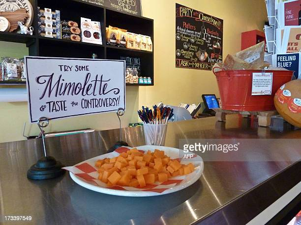 Francecheesefoodhealthdistribution Samples of mimolette cheese are offered to customers at Cheestique in Arlington Virginia on July 11 2013 Jill...