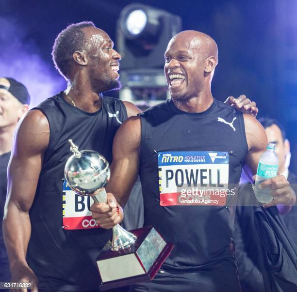 Usain Bolt and Asafa Powell of Jamaica gesture as they celebrate after winning the Nitro trophy in the Nitro series during round 3 of the Nitro...