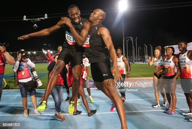 Usain Bolt and Asafa Powell of Usain Bolt's AllStar team celebrate after winning the event during the Melbourne Nitro Athletics Series at Lakeside...