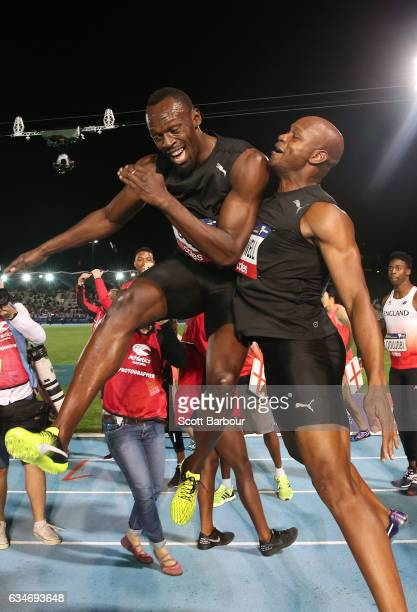 Usain Bolt and Asafa Powell of Usain Bolt's AllStar team celebrate after winning the Mens 150 Metre Race during the Melbourne Nitro Athletics Series...