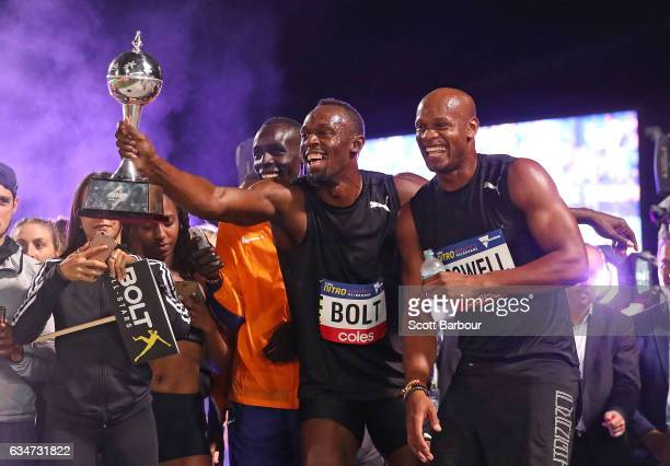 Usain Bolt and Asafa Powell of Usain Bolt's AllStar team celebrate with the trophy after winning the event during the Melbourne Nitro Athletics...