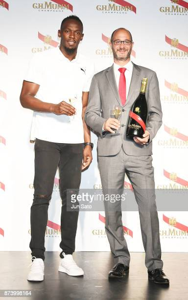Usain Bolt and cellar master Didier Mariotti attend the GH Mumm Champagne promotion at Nicoffare on November 14 2017 in Tokyo Japan