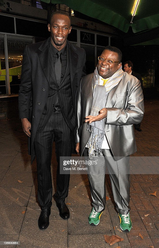 Usain Bolt (L) and Isaac Julien arrive at the Zeitz Foundation and ZSL Gala at London Zoo on November 22, 2012 in London, England.
