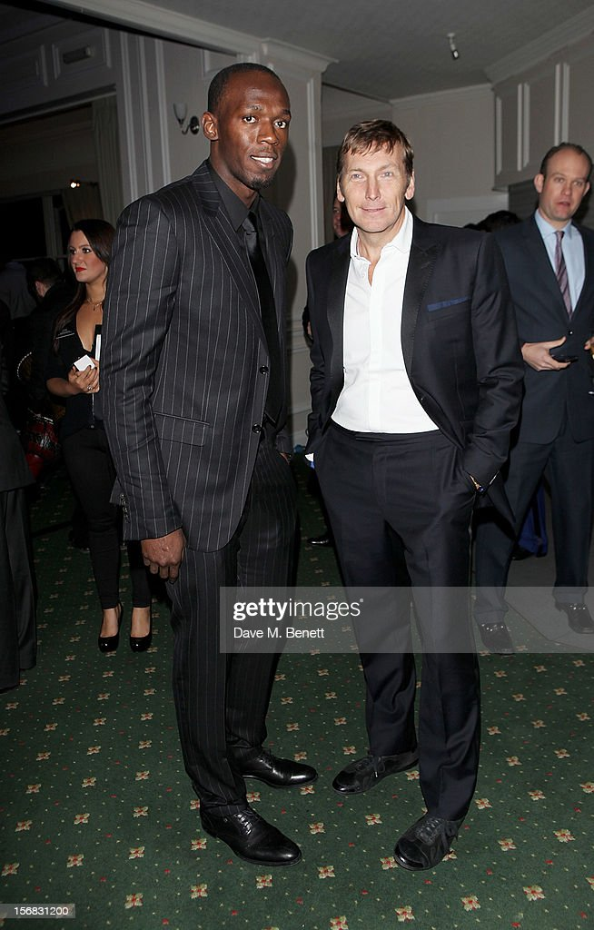 Usain Bolt (L) and Zeitz Foundation founder Jochen Zeitz arrive at the Zeitz Foundation and ZSL Gala at London Zoo on November 22, 2012 in London, England.