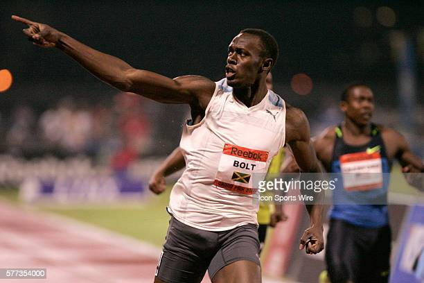 Usain Bolt competes against Tyson Gay in the Men's 100 meter dash at the Reebok Grand Prix in New York City Bolt won the race setting a new World...
