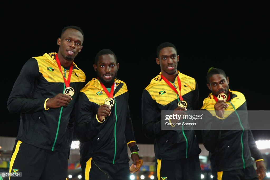 <a gi-track='captionPersonalityLinkClicked' href=/galleries/search?phrase=Usain+Bolt&family=editorial&specificpeople=604196 ng-click='$event.stopPropagation()'>Usain Bolt</a>, Nickel Ashmeade Kemar Bailey-Cole and <a gi-track='captionPersonalityLinkClicked' href=/galleries/search?phrase=Jason+Livermore&family=editorial&specificpeople=7165850 ng-click='$event.stopPropagation()'>Jason Livermore</a> of Jamaica pose on the podium during the medal ceremony for the Men's 4x100 metres relay at Hampden Park during day ten of the Glasgow 2014 Commonwealth Games on August 2, 2014 in Glasgow, United Kingdom.