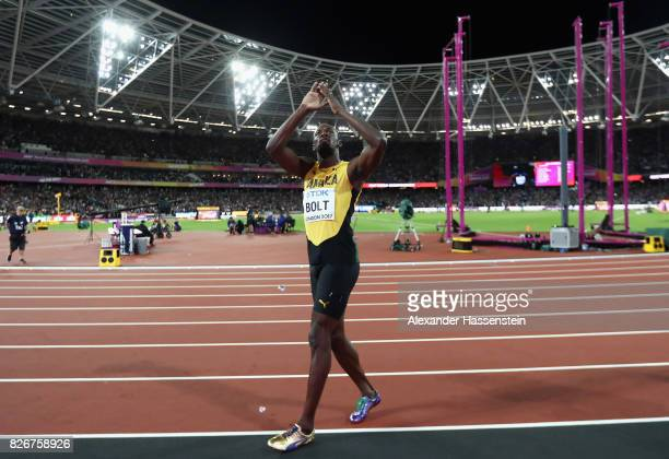 Usain Bolt of Jamaica acknowledges the cheers of the crowd on his lap of honour following his third place finish in the Men's 100 metres final during...