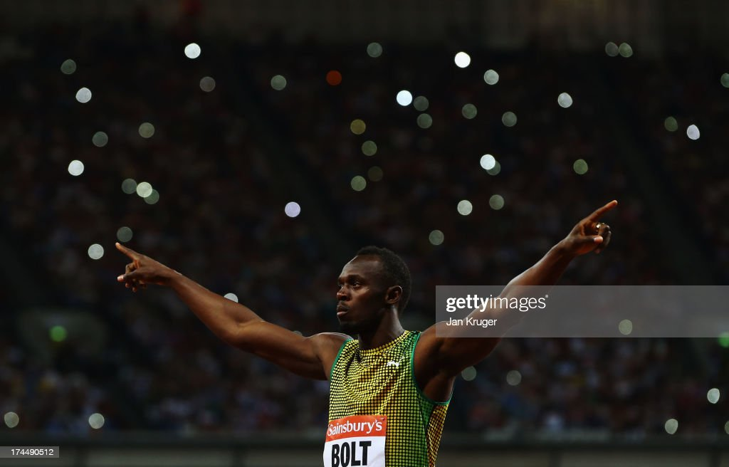 <a gi-track='captionPersonalityLinkClicked' href=/galleries/search?phrase=Usain+Bolt&family=editorial&specificpeople=604196 ng-click='$event.stopPropagation()'>Usain Bolt</a> of Jamaica acknowledges the crowd ahead of the Men's 100m A race on day one during the Sainsbury's Anniversary Games - IAAF Diamond League 2013 at The Queen Elizabeth Olympic Park on July 26, 2013 in London, England.