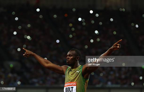 Usain Bolt of Jamaica acknowledges the crowd ahead of the Men's 100m A race on day one during the Sainsbury's Anniversary Games IAAF Diamond League...