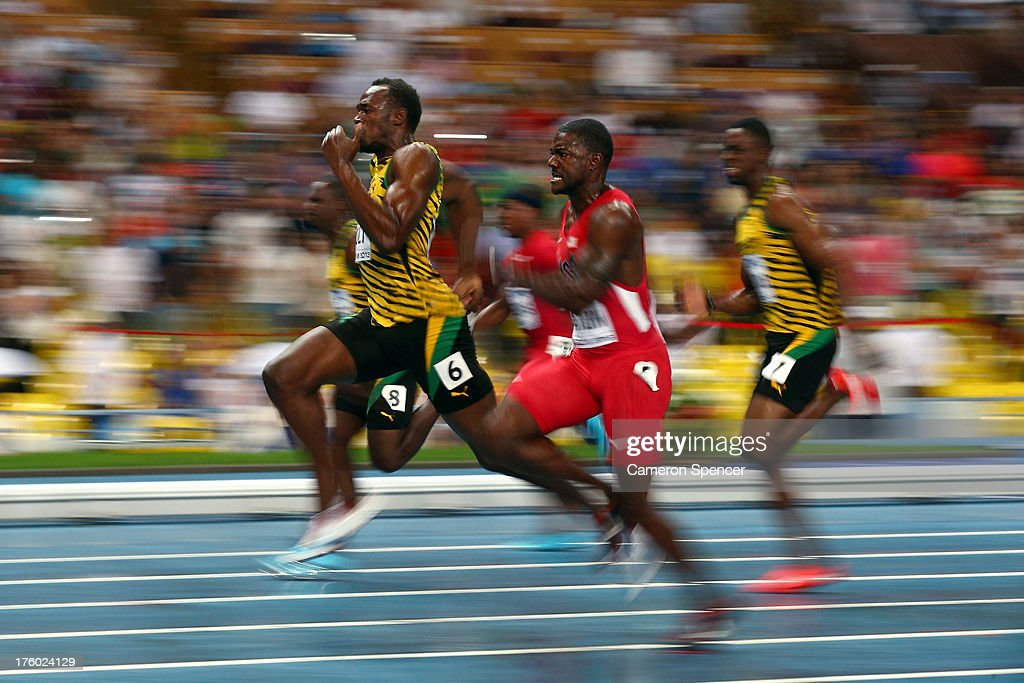<a gi-track='captionPersonalityLinkClicked' href=/galleries/search?phrase=Usain+Bolt&family=editorial&specificpeople=604196 ng-click='$event.stopPropagation()'>Usain Bolt</a> of Jamaica (L) and <a gi-track='captionPersonalityLinkClicked' href=/galleries/search?phrase=Justin+Gatlin&family=editorial&specificpeople=162752 ng-click='$event.stopPropagation()'>Justin Gatlin</a> of the United States compete in the Men's 100 metres Final during Day Two of the 14th IAAF World Athletics Championships Moscow 2013 at Luzhniki Stadium on August 11, 2013 in Moscow, Russia.