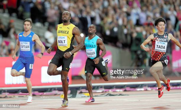 Usain Bolt of Jamaica and Shuhei Tada of Japan compete in the Men's 100m heat during day one of the 16th IAAF World Athletics Championships London...