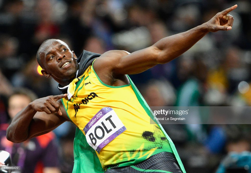 <a gi-track='captionPersonalityLinkClicked' href=/galleries/search?phrase=Usain+Bolt&family=editorial&specificpeople=604196 ng-click='$event.stopPropagation()'>Usain Bolt</a> of Jamaica celebrates after crossing the finish line to win the gold medal in the Men's 100m Final on Day 9 of the London 2012 Olympic Games at Olympic Stadium on August 5, 2012 in London, England.
