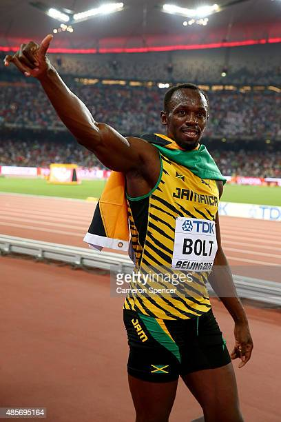 Usain Bolt of Jamaica celebrates after crossing the finish line to win gold in the Men's 4x100 Metres Relay final during day eight of the 15th IAAF...