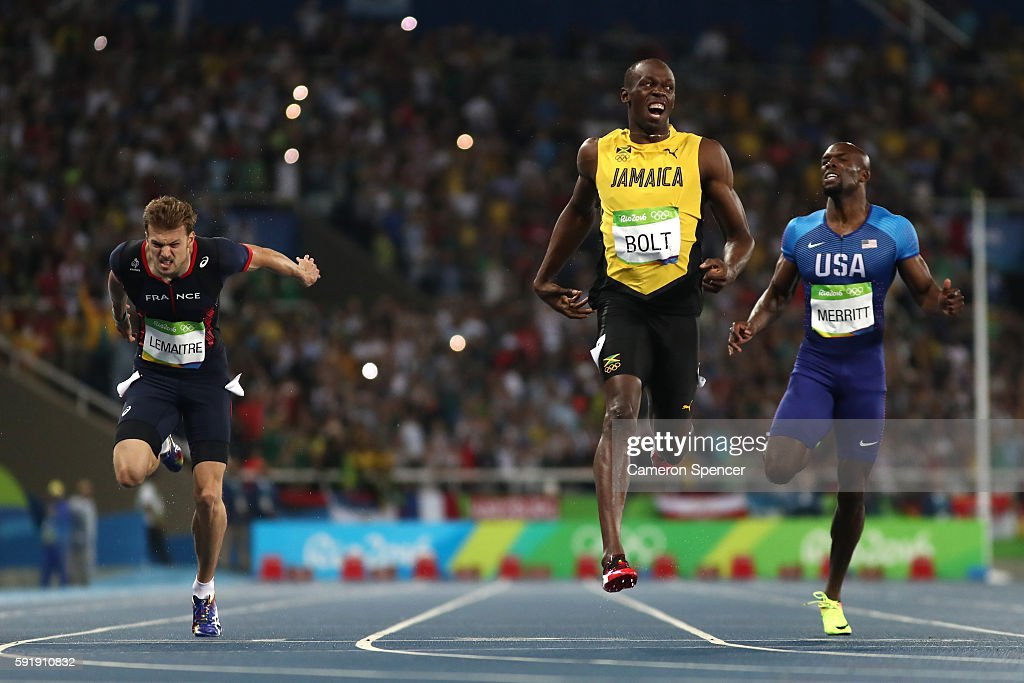 Usain Bolt of Jamaica celebrates after crossing the finish line to win the Mens 200m final on Day 13 of the Rio 2016 Olympic Games at the Olympic...