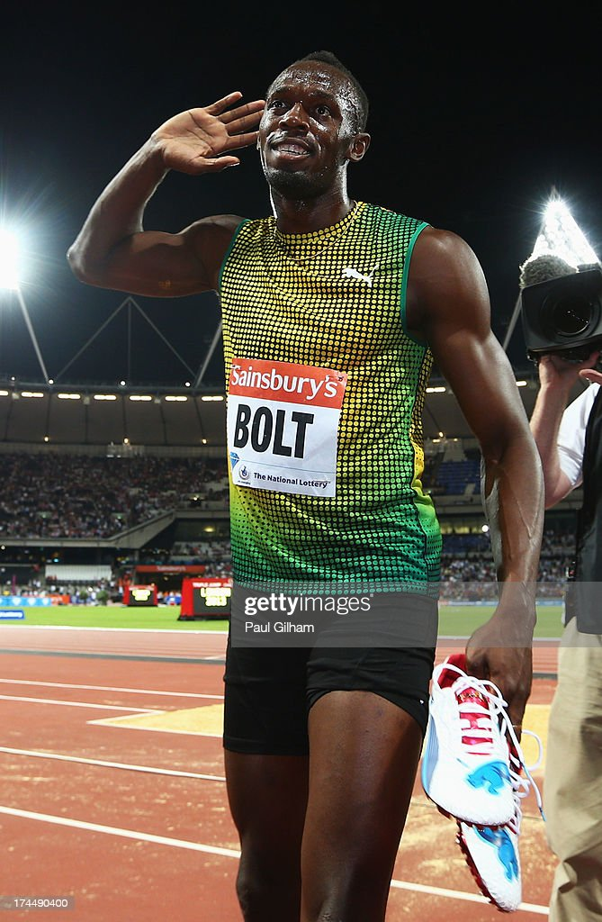 <a gi-track='captionPersonalityLinkClicked' href=/galleries/search?phrase=Usain+Bolt&family=editorial&specificpeople=604196 ng-click='$event.stopPropagation()'>Usain Bolt</a> of Jamaica celebrates after crossing the line first in the Men's 100m A race on day one during the Sainsbury's Anniversary Games - IAAF Diamond League 2013 at The Queen Elizabeth Olympic Park on July 26, 2013 in London, England.
