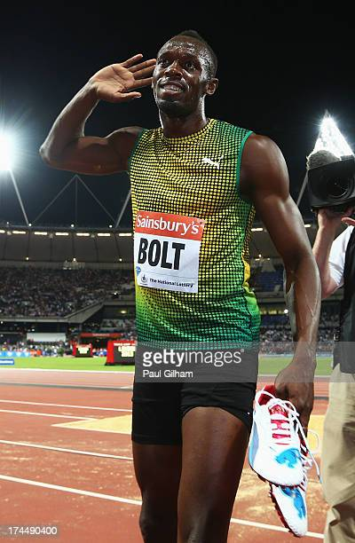 Usain Bolt of Jamaica celebrates after crossing the line first in the Men's 100m A race on day one during the Sainsbury's Anniversary Games IAAF...
