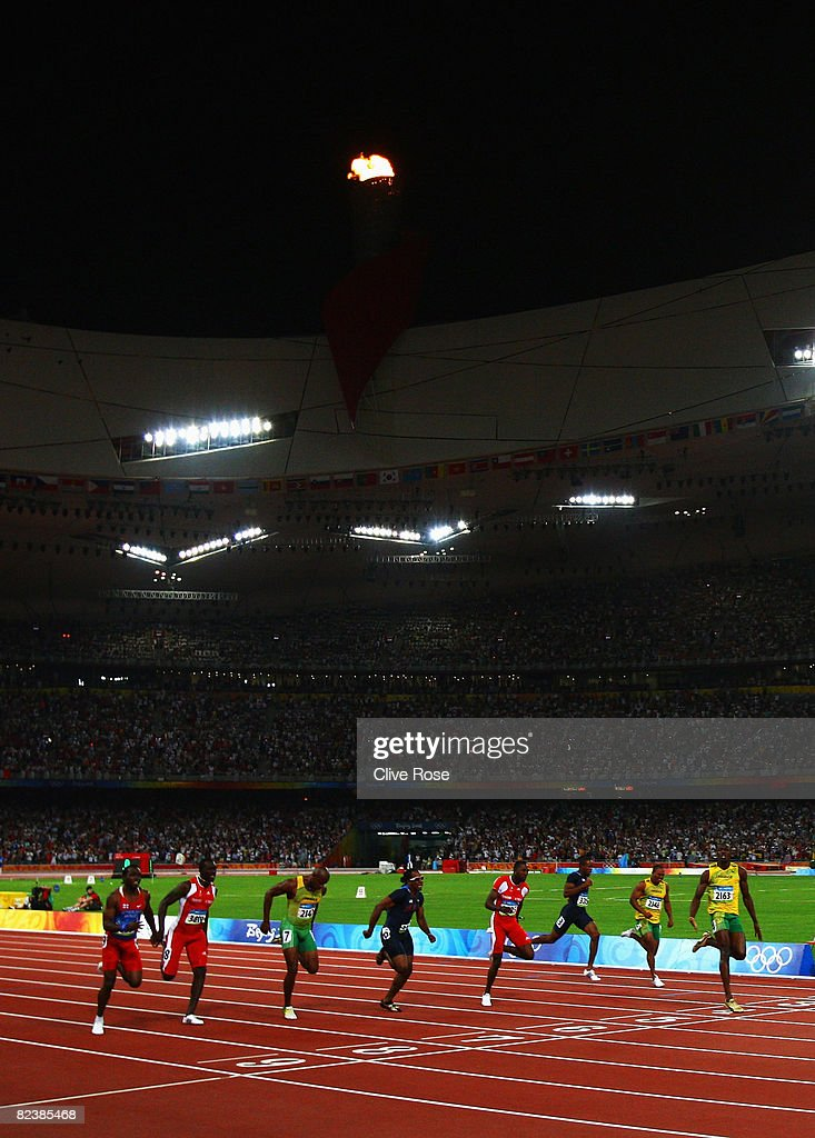 Usain Bolt of Jamaica celebrates after crossing the line in the Men's 100m Final at the National Stadium on Day 8 of the Beijing 2008 Olympic Games on August 16, 2008 in Beijing, China. Bolt finished the event in first place with a time of 9.69, a new World Record.