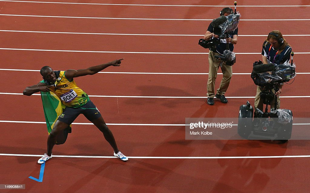 Usain Bolt of Jamaica celebrates after his win gold in the Men's 100m Final on Day 9 of the London 2012 Olympic Games at the Olympic Stadiumat Olympic Stadium on August 5, 2012 in London, England.