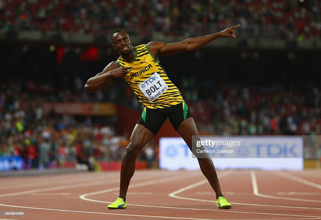 Usain Bolt of Jamaica celebrates after winning gold in the Men's 100 metres final during day two of the 15th IAAF World Athletics Championships Beijing 2015 at Beijing National Stadium on August 23, 2015 in Beijing, China.
