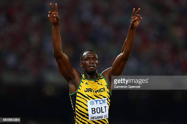 Usain Bolt of Jamaica celebrates after winning gold in the Men's 100 metres final during day two of the 15th IAAF World Athletics Championships...